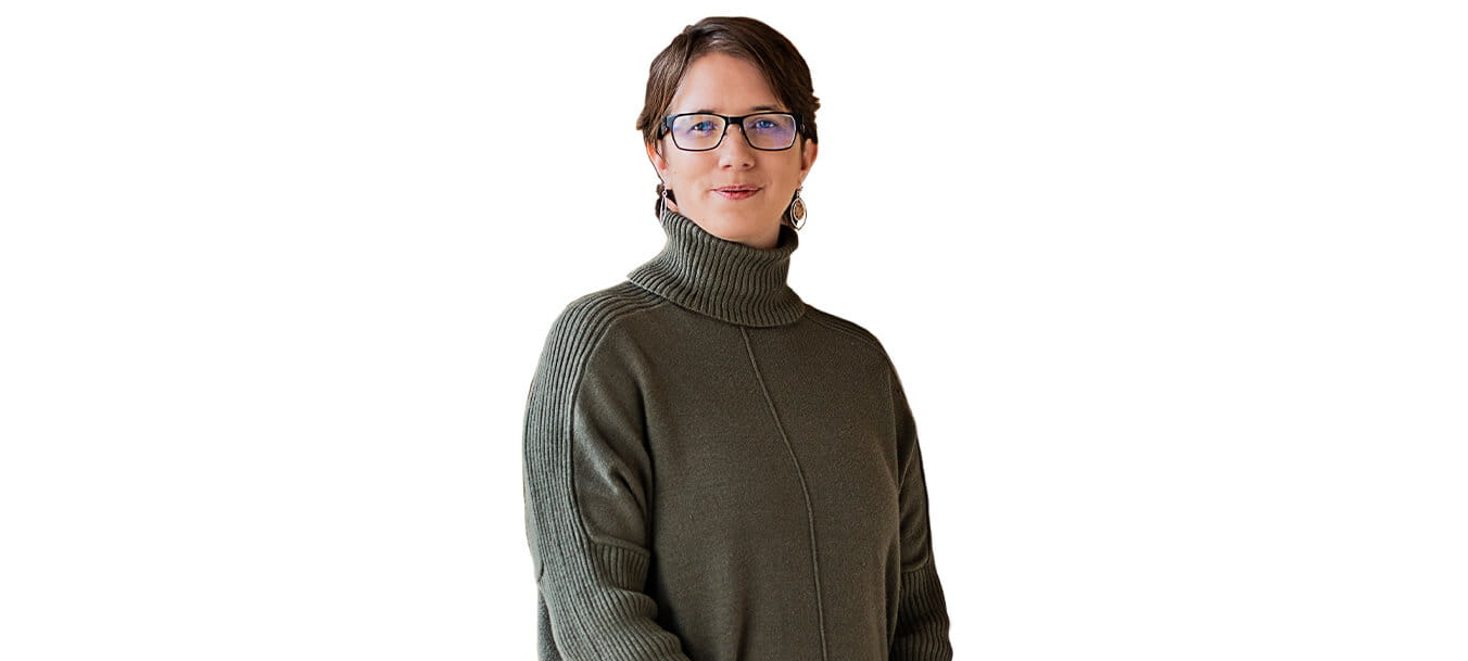 Dressed in a turtleneck, Dr. Amanda Robinson-Chadwell stands in front of an all-white background.